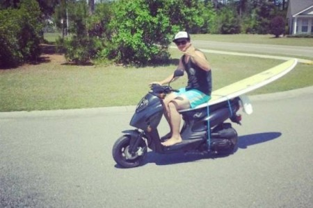 Tim-Donovan-surfboard-on-a-Moped